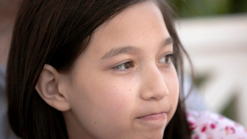 A 12-year-old whose coronavirus nightmare began with unusual stomach pains and her lips turning blue said she 'died and came back' after a heart attack
