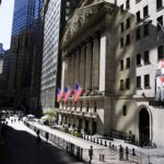 Dow closes 650 points lower, as concerns mount over rise in coronavirus infections