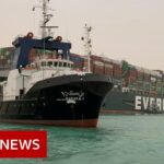 Suez Canal blocked after huge container ship wedged across it  – BBC News
