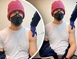 Ryan Reynolds shows off muscular arms as he gets first COVID-19 vaccine dose