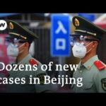 Beijing on partial lockdown after new coronavirus cluster emerges | DW News
