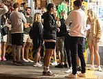 Covid-19 Australia: Bondi locals enjoy night out on the streets buying takeaway alcohol