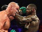 Deontay Wilder's fiancee accuses Tyson Fury of 'buying time' after his positive Covid-19 test